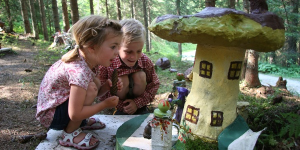 Kids marvel at the Mushroom Town of Mushroom Nature Path