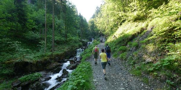 Hikers on the path through the ravine Gaisalptobel