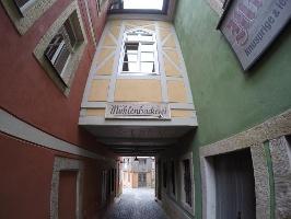 Foto Die kleine Straße durch Schmilka (geradezu die Braumanufaktur, rechts die Mühlenbäckerei)