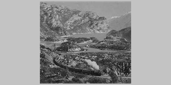 The local railway MAR (Mori - Arco - Riva). In the background lake Loppio
