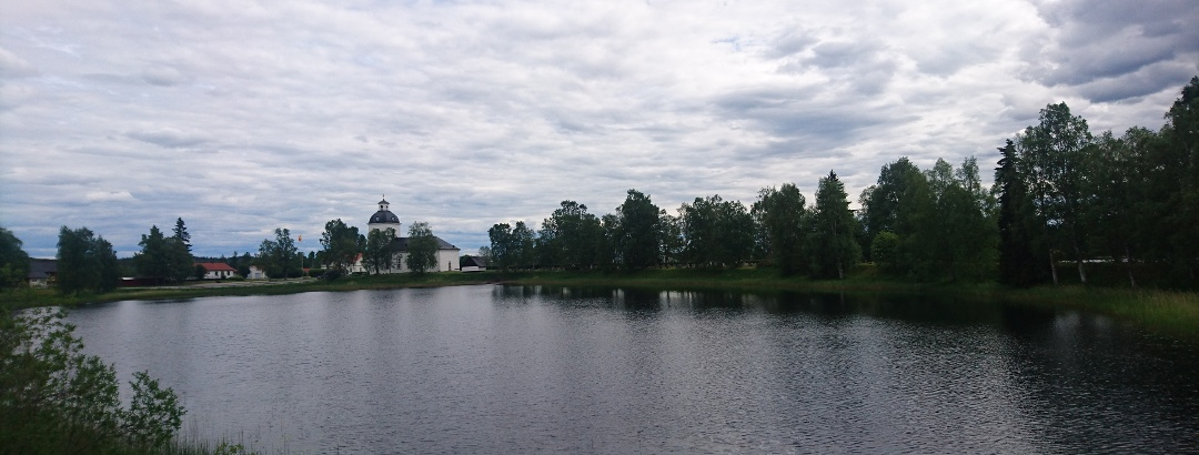 The Church of Ytterhogdal, seen from a distance by the water