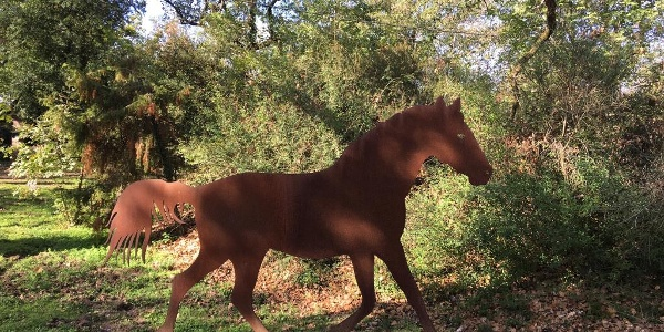 Metal horse sculpture outside Pievasciata at ~5.1 km