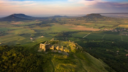 Castle of Csobánc from above with Gulács, Badacsony, Szigliget Hill and Szent György Hill on the horizon