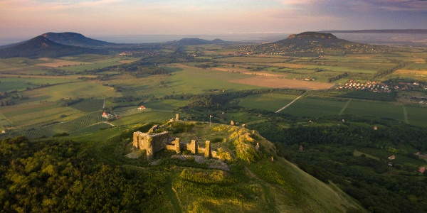 Castle of Csobánc from above with Gulács, Badacsony, Szigliget Hill and Szent György Hill on the horizon
