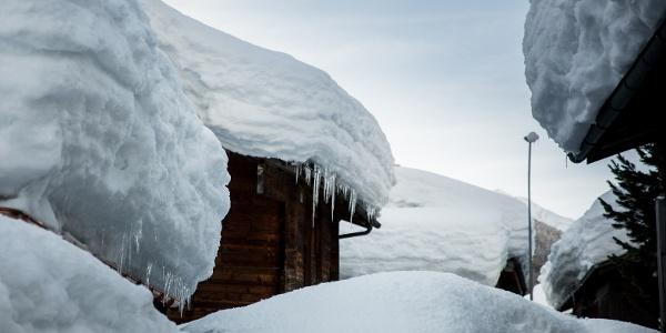Snow-covered village centre Oberwald
