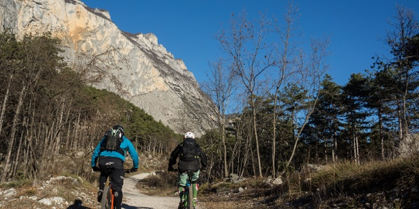 Passage of the route with the rock face of Monte Brento in the background
