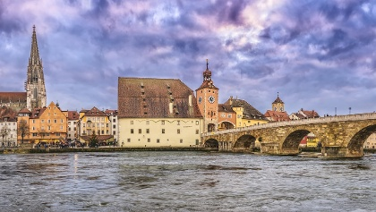The famous city silhoutte of Regensburg including the Stone Bridge and the Danube shore