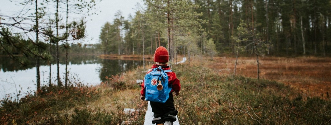 Small hiker discovering the finnish landscape