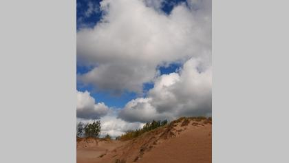 Summer clouds over a sand dune