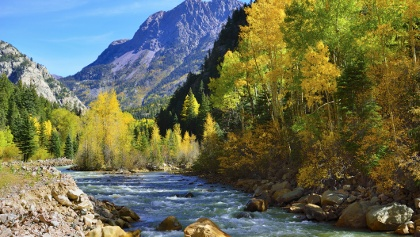 Thes scenic views of rushing rivers, aspen groves and the Rocky Mountains from the bike path