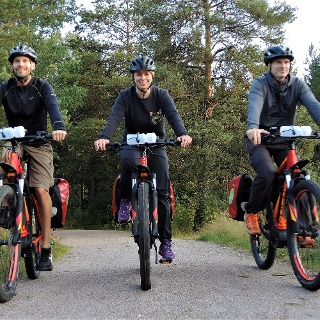 Happy eBikers riding on nice forest tracks.