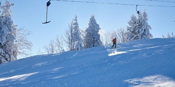 Skitour entlang der Piste