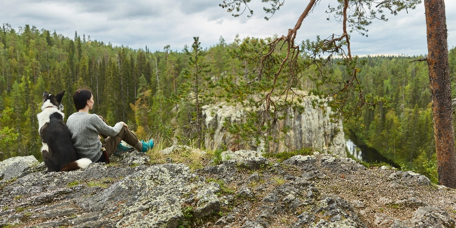 Passing Ristikallio rock during the Karhunkierros trail
