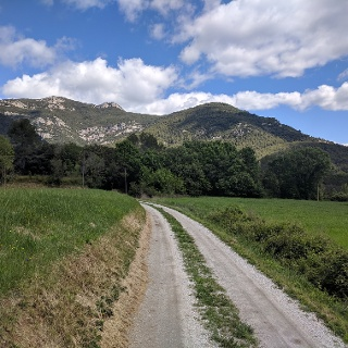 Passing through rural land around Sales de Llierca towards the mountains.