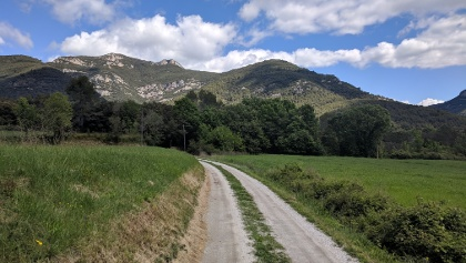Passing through rural land around Sales de Llierca towards the mountains.