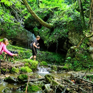 Hikers on the trail of 4 waterfalls