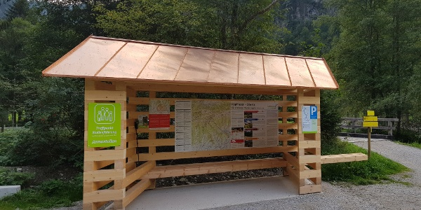 Info point Hopfriesen in Obertal valley with hiking map and trail signage
