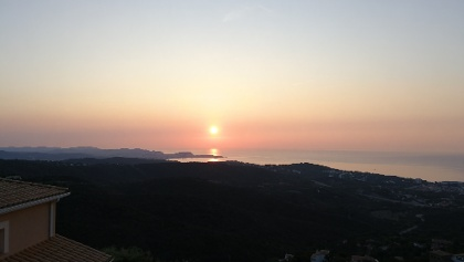 The sun is above the peninsula of Palamós