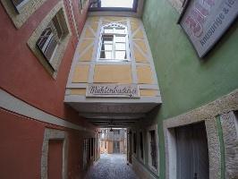 Foto Die schmale Gasse mit der urigen Mühlenbäckerei in Schmilka