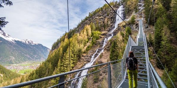Walking past the Stuibenfall Waterfall