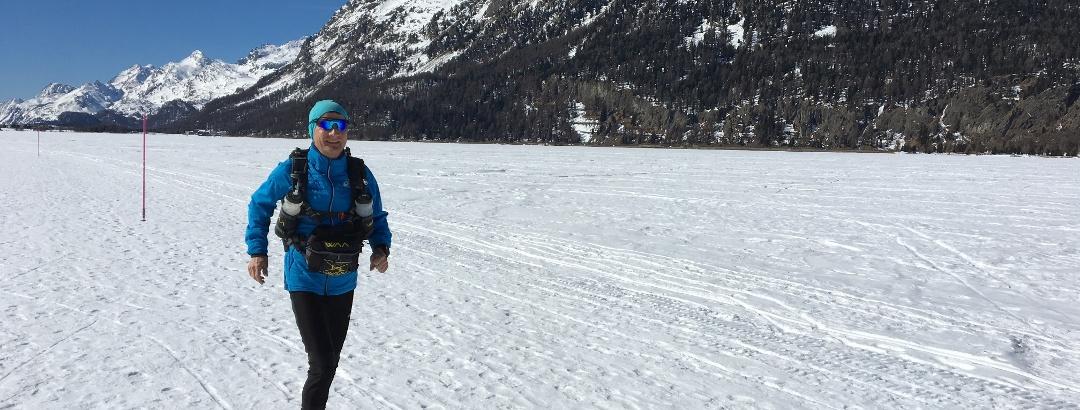 Trail runner on the lake of Silvaplana