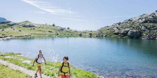 Walking at the Lake Langsee - Spronser Lakes