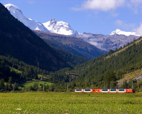 Walking in view of the Matterhorn Gotthard Bahn railway line