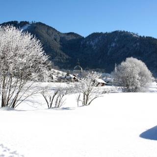 Winterwanderung Sonnenweg - Blick auf das Kloster Ettal
