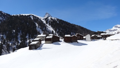 View of the hamlet of Zmutt with the tip of the Matterhorn
